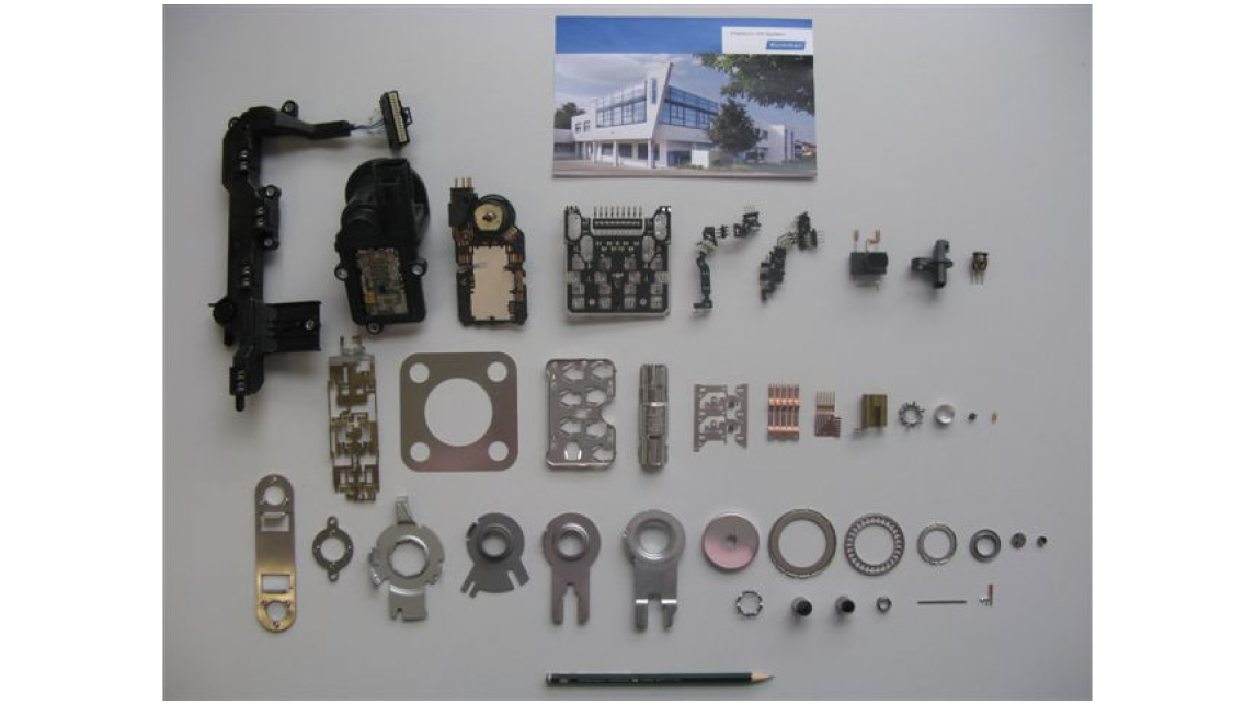 Logo Stampings and Metal-Plastic-Compound Parts